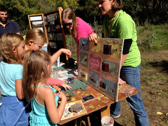 Ellen helps children label the lifecycle of a salmon at the Bear Creek Salmon Festival.