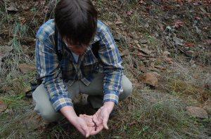 EE grad student Jason Wilson holding the salamander